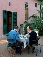 Tour group members breakfast on veranda at Villa Rosa agriturisimo, Panzano in Chianti, Ital