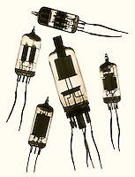 Five electronic tubes on a beige background