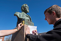 Class assignment for Geosciences &quot;Principles of GIS&quot;: Zachary Tidwell takes note of the coordinates of the Stephen D. Lee statue.<br />  (photo by Megan Bean / &copy; Mississippi State University)