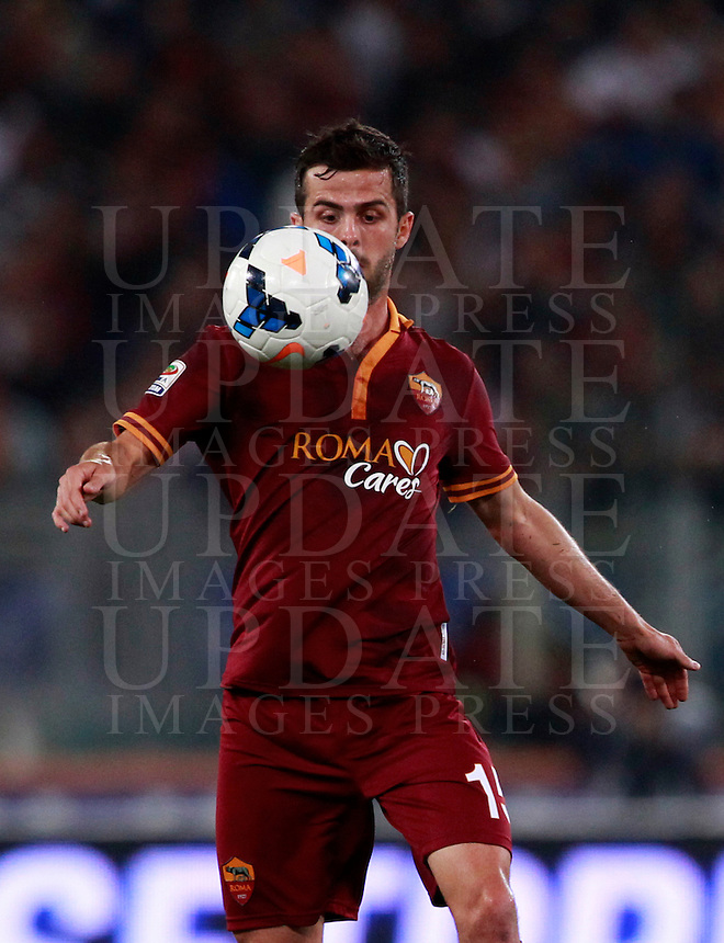 Calcio, Serie A: Roma vs Milan. Roma, stadio Olimpico, 25 aprile 2014.<br /> AS Roma midfielder Miralem Pjanic, of Bosnia, controls the ball during the Italian Serie A football match between AS Roma and AC Milan at Rome's Olympic stadium, 25 April 2014.<br /> UPDATE IMAGES PRESS/Isabella Bonotto
