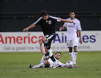 DC United forward Jaime Moreno (99) tries to avoid the tackle from Real Salt Lake midfielder Dema Kovalenko (21). DC United defeated Real Salt Lake 4-1, at RFK Stadium in Washington DC, Saturday April 26, 2008.