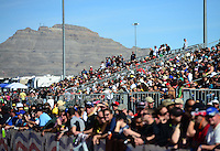 Oct. 27, 2012; Las Vegas, NV, USA: NHRA fans in the grandstands during qualifying for the Big O Tires Nationals at The Strip in Las Vegas. Mandatory Credit: Mark J. Rebilas-