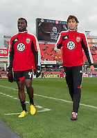 06 October 2012: D.C. United defender/midfielder Brandon McDonald #4 and D.C. United defender Dejan Jakovic #5 coming off the pitch after warm-up in an MLS game between D.C. United and Toronto FC at BMO Field in Toronto, Ontario..D.C. United won 1-0..