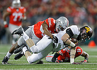 Ohio State Buckeyes linebacker Raekwon McMillan (5) brings  down Minnesota Golden Gophers tight end Brandon Lingen (86)   during an NCAA football game between the Ohio State Buckeyes and the Minnesota Golden Gophers at Ohio Stadium on Saturday, November 7, 2015. (Columbus Dispatch photo by Fred Squillante)