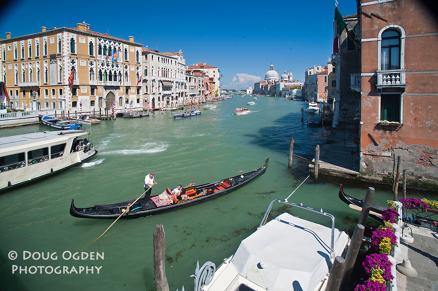 Gondoliers on the Grand Canal, Venice, Italy