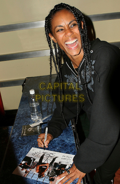 JADA PINKETT SMITH .Signs autographs after her band, Wicked Wisdom opened the show for Alice Cooper at The Grove of Anaheim in Anaheim, California, USA, August 15, 2006..half length black top dreadlocks hair rock band music backstage concert funny laughing smiling.Ref: DVS.www.capitalpictures.com.sales@capitalpictures.com.©Debbie VanStory/Capital Pictures