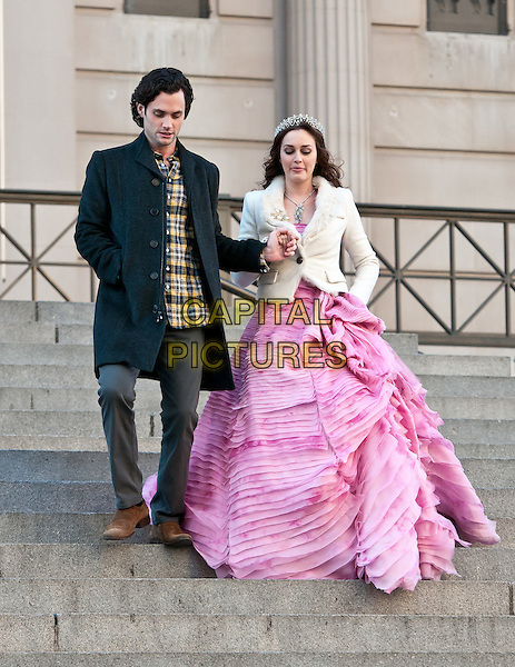 Penn Badgley & Leighton Meester.film 'Gossip Girl' on the steps of The Metropolitan Museum of Art, New York City, NY, USA..6th January 2012 .on the set of filming acting costume black jacket grey gray trousers yellow check shirt pink gown dress white tiara holding hands full length.CAP/ADM/CS.© Chris Smith/AdMedia/Capital Pictures