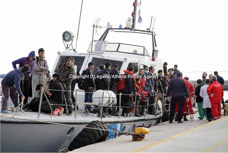 Pictured: Dozens of people disembark the Coastguard vessel that transferred them to safety Thursday 27 November 2014<br /> Re: One of the largest refugee boats in recent months has disembarked refugees in Ierapetra, Crete. The freighter Baris, carrying 700 people thought to be from Syria and Afghanistan, is being towed by a Greek frigate.<br /> Officials and Red Cross volunteers prepared an indoor basketball stadium as interim shelter in the southern Cretan port town of Ierapetra on Wednesday ahead of the migrants' expected arrival.<br /> Greek officials said the Baris, which lost propulsion on Tuesday, was being towed slowly in poor sea conditions and would arrive after nightfall, probably early Thursday.<br /> They said it was unclear which Mediterranean location had been the departure point for the 77-meter (254-foot) vessel, which was sailing under the flag of the Pacific nation of Kiribati.