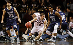 SIOUX FALLS, SD: MARCH 22: Brent Bach #15 of Bellarmine looks past Colorado Mines defenders Gokul Natesan #31 and Caleb Waitsman #23 during the Men's Division II Basketball Championship Tournament on March 22, 2017 at the Sanford Pentagon in Sioux Falls, SD. (Photo by Dick Carlson/Inertia)