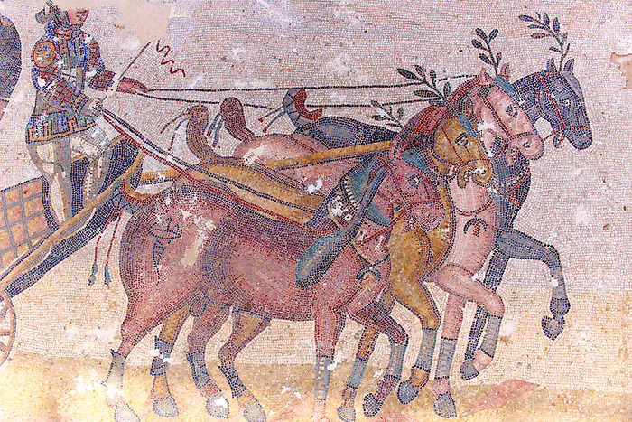 Detail of horses drawing a chariot at the Circus Maximus. Roman mosaics at the Villa Romana del Casale which containis the richest, largest and most complex collection of Roman mosaics in the world. Constructed  in the first quarter of the 4th century AD. Sicily, Italy. A UNESCO World Heritage Site.