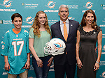 DAVIE, FL - JANUARY 28: The Miami Dolphins introduce new general manager Dennis Hickey, joined by his wife (R-L) Stephanie Hickey, daughter Breanna Hickey and son Barrett Hickey at a news conference at Miami Dolphins Davie training facility on January 28, 2014 in Davie, Florida. (Photo by Johnny Louis/jlnphotography.com)