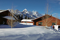 Snow covered Spur Ranch cabins at Dornans, Moose Visitors Center. Grand Teton National Park, Jackson Hole, Wyoming.