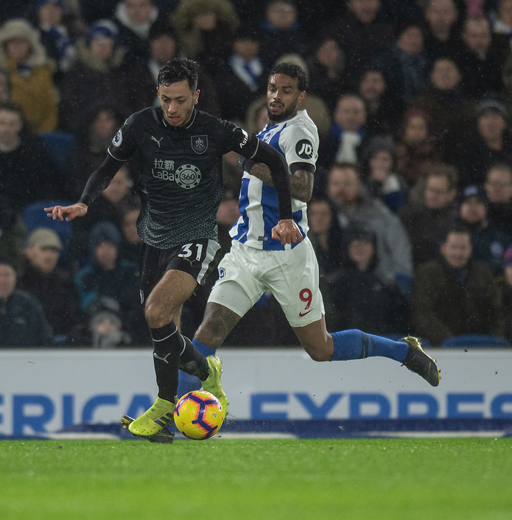 Burnley's Dwight McNeil (left) under pressure from Brighton &amp; Hove Albion's Jurgen Locadia (right)  <br /> <br /> <br /> Photographer David Horton/CameraSport<br /> <br /> The Premier League - Brighton and Hove Albion v Burnley - Saturday 9th February 2019 - The Amex Stadium - Brighton<br /> <br /> World Copyright &copy; 2019 CameraSport. All rights reserved. 43 Linden Ave. Countesthorpe. Leicester. England. LE8 5PG - Tel: +44 (0) 116 277 4147 - admin@camerasport.com - www.camerasport.com