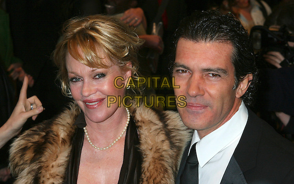 "MELANIE GRIFFITH & ANTONIO BANDERAS.""Take The Lead"" Film Premiere,. AMC Lincoln Square New York City, .New York, USA, 4th April 2006..half length married husband wife fur collar coat brown dress .Ref: IW.www.capitalpictures.com.sales@capitalpictures.com.©Capital Pictures"
