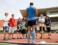USWNT forward Abby Wambach meets a group of children from a nearby U.S. military facility after practice at Anyang Sports Center in Seoul, South Korea.