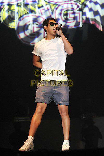 Rizzle Kicks .Performing live at the 'Girlguiding UK  Big Gig' at Wembley Arena, London, UK, 1st October 2011..music concert  live on stage full length white t-shirt singing microphone sunglasses  trainers blue grey gray shorts .CAP/MAR.© Martin Harris/Capital Pictures.