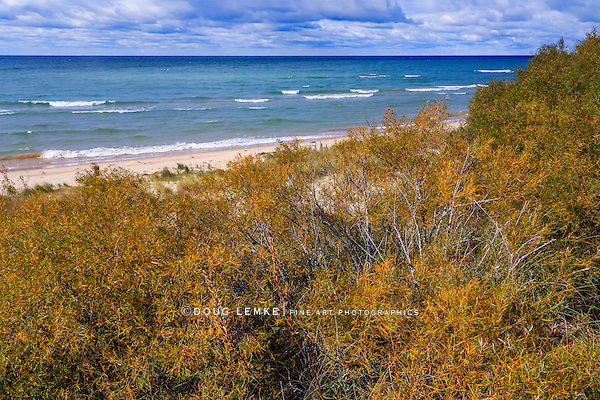 The beautiful beach and Lake Michigan shoreline on a spectacular autumn day near the Big Sable River at Ludington State Park, Ludington, Michigan, USA