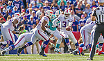 14 September 2014: Buffalo Bills running back Fred Jackson (22) takes a handoff from quarterback EJ Manuel (3) for a 1 yard gain in the fourth quarter against the Miami Dolphins at Ralph Wilson Stadium at Ralph Wilson Stadium in Orchard Park, NY. The Bills defeated the Dolphins 29-10 to win their home opener and start the season with a 2-0 record. Mandatory Credit: Ed Wolfstein Photo *** RAW (NEF) Image File Available ***