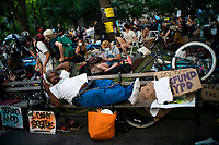 NEW YORK, NEW YORK - June 25: People rets as they take part in a protest encampment near NYC City hall on June 25, 2020 in New York, NY. Demonstrators are calling for $1 billion in cuts of NYPD, as they protest encampment near City Hall and NYPD headquarters ahead of the city July 1 budget deadline.  (Photo by Eduardo MunozAlvarez/VIEWpress)