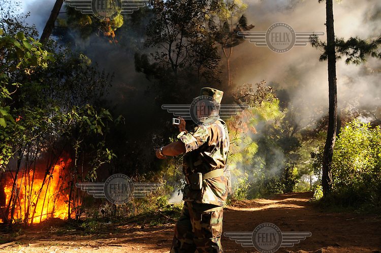 An army regiment based in Morelia burn down a drugs laboratory discovered in a remote mountainous area. In recent years, the Sinaloa cartel and 'La Familia de Michoacan' cartel have turned to the production of the highly addictive drug crystal meth, also known as methamphetamine, metamfetamine or its street name 'Ice'. The production takes place in small laboratories in remote areas which are equipped with sophisticated equipment. ..