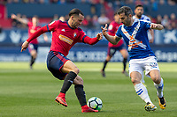 SADAR, PAMPLONA, SPAIN: The Football League, CA Osasuna vs Tenerife; Quique tries to escape with the ball of the Tenerife player, Iñaki on day 33 of Liga 123. April 1, 2018