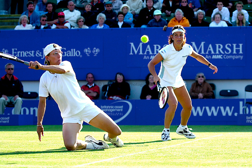 Photo. Rene Solari..21/6/01  .Eastbourne Day 4.  Martina Navratilova hits the shot of the day as she struggles to get up off the floor while volleying the ball and winning the point..