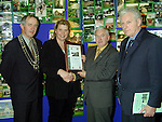 Wendy Byrne from Ardee Road Housing Scheme accepting the award for Best New Entry from Minister Dan Wallace T.D., Peter Savage, Chairman Louth County Council and Seamus Kirk T.D..Picture Paul Mohan Newsfile