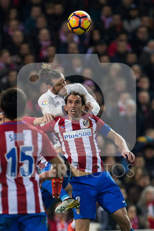 Real Madrid's Garet Bale Atletico de Madrid's Diego Godin  during the match of La Liga between Atletico de Madrid and Real Madrid at Vicente Calderon Stadium  in Madrid , Spain. November 19, 2016. (ALTERPHOTOS/Rodrigo Jimenez)