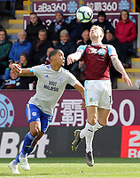 Burnley's Ashley Barnes vies for possession with Cardiff City's Lee Peltier<br /> <br /> Photographer Rich Linley/CameraSport<br /> <br /> The Premier League - Saturday 13th April 2019 - Burnley v Cardiff City - Turf Moor - Burnley<br /> <br /> World Copyright © 2019 CameraSport. All rights reserved. 43 Linden Ave. Countesthorpe. Leicester. England. LE8 5PG - Tel: +44 (0) 116 277 4147 - admin@camerasport.com - www.camerasport.com