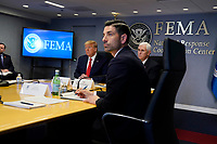 United States President Donald J. Trump and US Vice President Mike Pence listen during a teleconference with governors at the Federal Emergency Management Agency headquarters, Thursday, March 19, 2020, in Washington, DC. Acting Secretary of Homeland Security Chad Wolf, is second from right. <br /> Credit: Evan Vucci / Pool via CNP/AdMedia