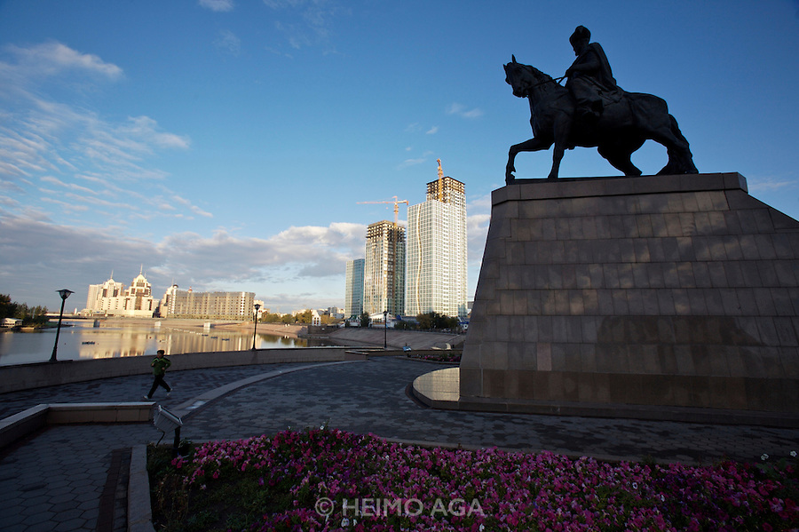 Sunrise at Ishim River, new appartment buildings. Statue of Kenesary Khan riding his horse.