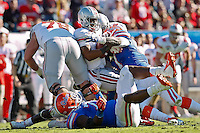 January 02, 2012:    Florida Gators defensive end Ronald Powell (7) sacks Ohio State Buckeyes quarterback Braxton Miller (5) during first half action at the 2012 Taxslayer.com Gator Bowl between the Florida Gators and the Ohio State Buckeyes at EverBank Field in Jacksonville, Florida.