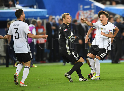 Germany players with Jonas Hector (L-r), goalkeeper Manuel Neuer, Mesut Oezil celebrate after winning the penalty shoot-out of the UEFA EURO 2016 quarter final soccer match between Germany and Italy at the Stade de Bordeaux in Bordeaux, France, 02 July 2016.