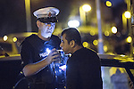 © Joel Goodman - 07973 332324 . 16 August 2013 . Manchester , UK . Inspector Bailey-Smith stops and breathalyses motorist Aziz Marf on suspicion of careless driving (inappropriate speed) . Drive along with Inspector Matt Bailey-Smith ( 16366 ) of Greater Manchester Police 's Serious Collision Unit . Photo credit : Joel Goodman