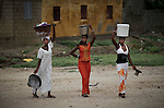World Water Day. Three senegalese women are returning from to wash in the river