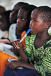 "A girl follows as the teacher writes on the blackboard in a primary school class in Chidyamanga, a village in southern Malawi that has been hard hit by drought in recent years, leading to chronic food insecurity, especially during the ""hunger season,"" when farmers are waiting for the harvest."