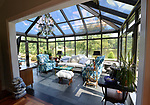 """The conservatory at the rear of the home gives a great view of the lake. """"At Home"""" with Margaret Lowery in her Lake Christine Drive home in Belleville, IL on July 24, 2019. <br /> Photo by Tim Vizer"""