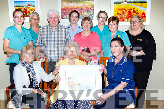 Grace McCrae President of the Kerry Parkinson Association presents a painting to Our Lady of Lourdes Caring home Killarney in appreciation of the care the gave her late husband Jack. Front row l-r: Patience Williams, Grace McCrae, Noreen Riordan. Back row: Justyna Nowak, Magda micka, Connie Doolan, Claire Nagle, Brenda Edmonds, Trish O'Rourke, Ellsie McDonnell  and Linda Smith