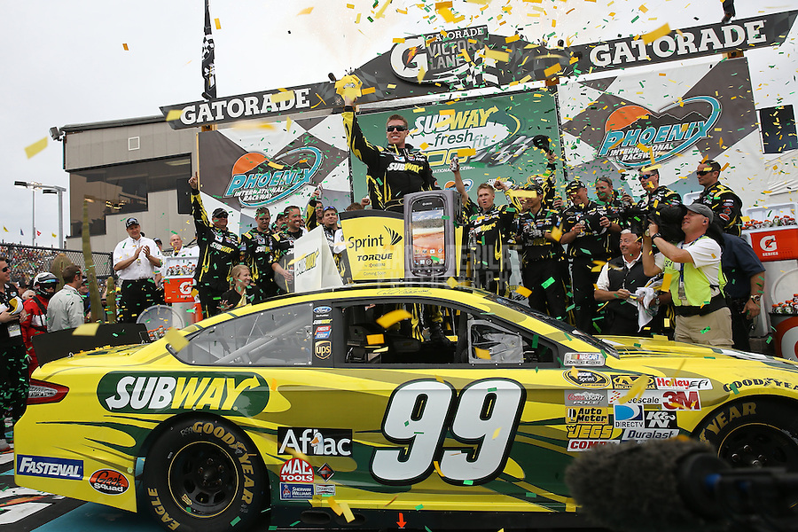 Mar. 3, 2013; Avondale, AZ, USA; NASCAR Sprint Cup Series driver Carl Edwards celebrates after winning the Subway Fresh Fit 500 at Phoenix International Raceway. Mandatory Credit: Mark J. Rebilas-