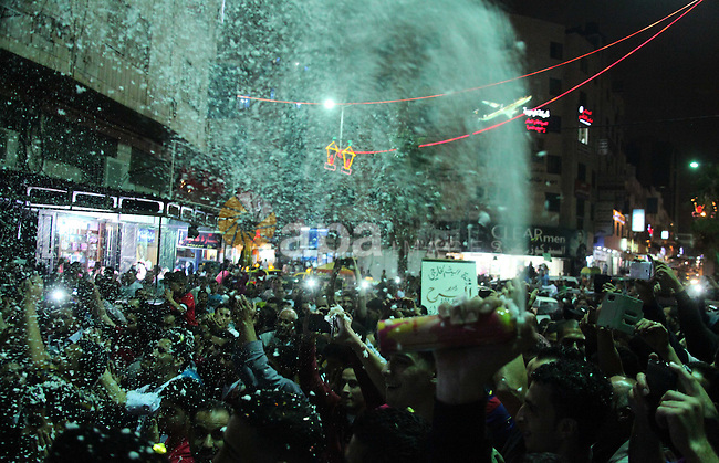"Palestinians take part a rally to celebrate after hearing the news of the kidnapping of an Israeli soldier in Gaza strip,  in the West Bank city of Hebron, on July 20, 2014. The Hamas' armed wing said it has captured an Israeli soldier during fighting in the Gaza Strip. Speaking on a Hamas television station, spokesman Abu Ubaida said ""we have captured a Zionist soldier and the occupation has not admitted that."" The claim could not immediately be verified and the Israeli military said it was investigating the report. Photo by Mamoun Wazwaz"