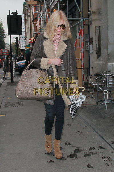 Fearne Cotton spotted in central London, England..November 8th, 2011.full length sunglasses shades pink top brown sheepskin leather jacket jeans boots tan beige bag purse umbrella .CAP/HIL.©John Hillcoat/Capital Pictures .