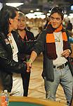 Scotty Nguyen shakes hands with Dario Minieri