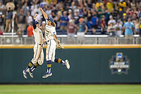 Michigan Wolverines outfielder Jordan Brewer (22) celebrates with teammate Jack Blomgren (2) after beating the Vanderbilt Commodores in Game 1 of the NCAA College World Series Finals on June 24, 2019 at TD Ameritrade Park in Omaha, Nebraska. Michigan defeated Vanderbilt 7-4. (Andrew Woolley/Four Seam Images)