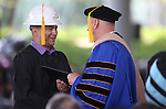 President Chet Burton congratulates Bachelor of Technology graduate Victor Mejorado during the 45th annual Western Nevada College Commencement ceremony in Carson City, Nev., on Monday, May 23, 2016. A record 556 graduates received 598 degrees.<br />