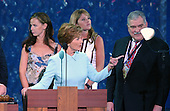 New York, NY - August  31, 2004 -- First Lady Laura Bush, left center, and her daughters Jenna Bush, right center, and Barbara Bush, left,do a microphone check prior to their scheduled speeches at the 2004 Republican National Convention in Madison Square Garden in New York, New York on Tuesday, August 31, 2004.  Convention CEO Bill Harris looks on at right..Credit: Ron Sachs / CNP                                 .(RESTRICTION: No New York Metro or other Newspapers within a 75 mile radius of New York City)