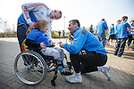Rangers captain Lee McCulloch signs the shirt of fan Abigail Webster, 7 from Paisley as supporters group Sons of Struth take a party of disabled kids on a tour of the training ground this morning