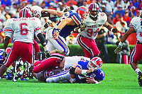Danny Wuerffel (7), Ben Washington (6), Mike washington (94), University of Florida Gators defeat the University of South Carolina Gamecocks 48-17 at Ben Hill Griffin Stadium, Florida Field, Gainseville, Florida, November 12, 1994 . (Photo by Brian Cleary/www.bcpix.com)
