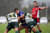 Joseph Casey is tackled by Loiloa Vea and Petelo Ikenasio. Counties Manukau Premier Club Rugby game between Ardmore Marist and Manurewa, played at Bruce Pulman Park Papakura on Saturday May 12th 2018. Ardmore Marist won the game 20 - 3 after leading 17 - 3 at halftime.<br /> Ardmore Marist - Katetistoti Nginingini try, penalty try, Latiume Fosita conversion, Latiume Fosita 2 penalties.<br /> Manurewa - Logan Fonoti penalty.<br /> Photo by Richard Spranger.