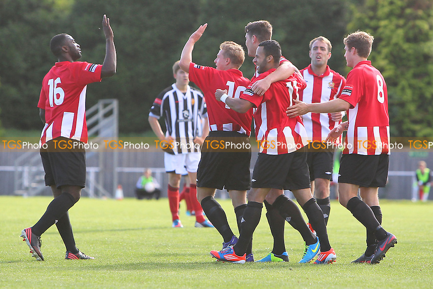 George Purcell (C) is congratulated by his team mates on scoring the third goal for AFC Hornchurch - AFC Hornchurch vs East Thurrock United - Ryman League Premier Division Football on Non-League Day at The Stadium, Upminster Bridge, Essex - 07/09/13 - MANDATORY CREDIT: Gavin Ellis/TGSPHOTO - Self billing applies where appropriate - 0845 094 6026 - contact@tgsphoto.co.uk - NO UNPAID USE