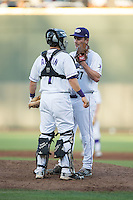 Winston-Salem Dash catcher Brett Austin (7) has a chat on the mound with starting pitcher Jordan Stephens (27) during the game against the Potomac Nationals at BB&T Ballpark on May 13, 2016 in Winston-Salem, North Carolina.  The Dash defeated the Nationals 5-4 in 11 innings.  (Brian Westerholt/Four Seam Images)